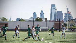 Students playing soccer on completed Temple Sports Complex field